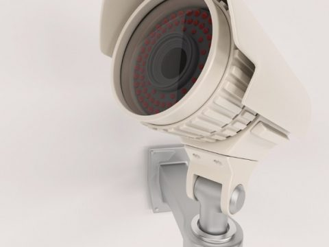 close-up-surveillance-camera-wall