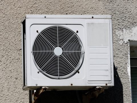old-air-conditioner-hangs-wall-residential-building-high-quality-photo